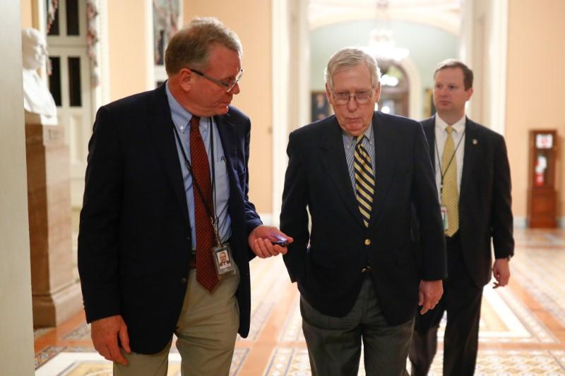 Senate Majority Leader McConnell walks to the Senate Chamber ahead of a vote on Capitol Hill in Washington