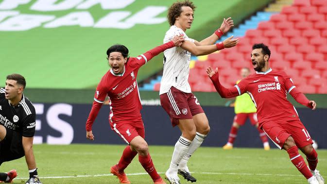 Gelandang Liverpool, Takumi Minamino, menyumbangkan satu gol saat timnya bersua Arsenal pada laga Community Shield 2020 di Stadion Wembley, Sabtu (29/8/2020) dini hari WIB. (Justin Tallis/Pool via AP)