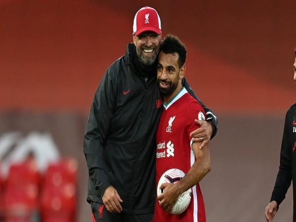 Liverpool manager Jurgen Klopp with Mohamed Salah (Photo/ Liverpool Twitter)