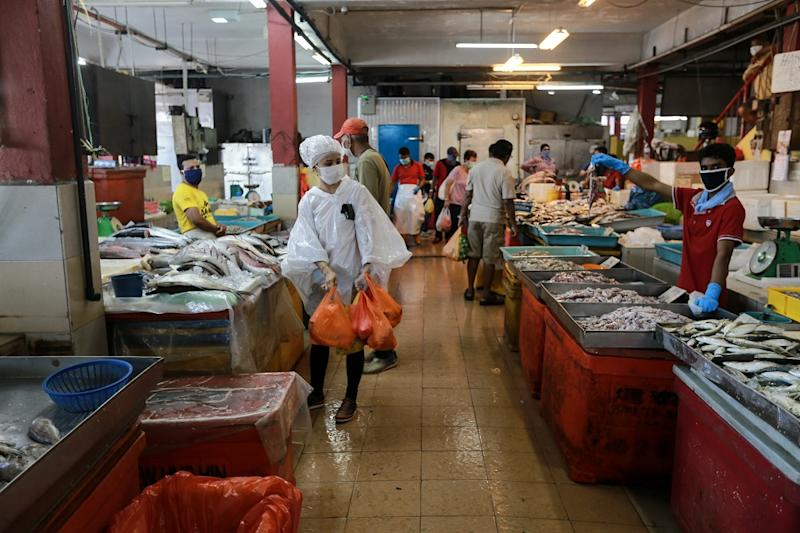 The Defence Minister said the new restrictions could entail shorter operating hours for markets or eateries during the movement control order period. — Picture by Ahmad Zamzahuri