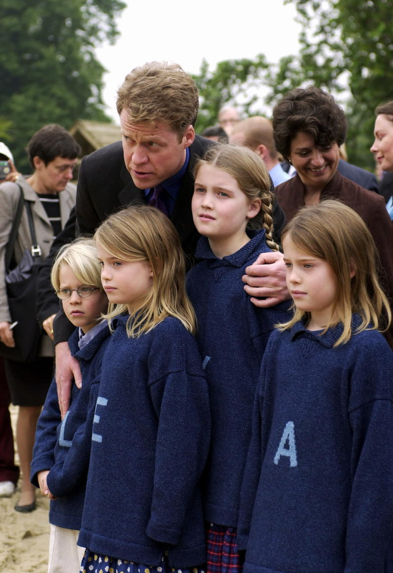 Louis, Eliza, Kitty and Amelia pose in monogrammed jumpers with their father Earl Spencer