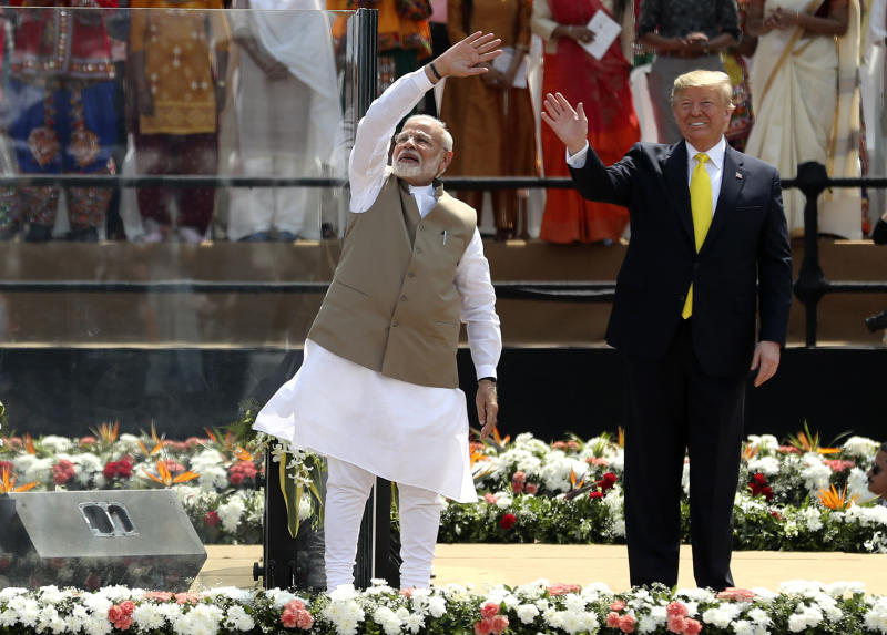U.S. President Donald Trump and Indian Prime Minister Narendra Modi wave to the crowd at Sardar Patel Stadium in Ahmedabad, India, Monday, Feb. 24, 2020. India poured on the pageantry with a joyful, colorful welcome for President Donald Trump on Monday that kicked off a whirlwind 36-hour visit meant to reaffirm U.S.-India ties while providing enviable overseas imagery for a president in a re-election year. (AP Photo/Aijaz Rahi)