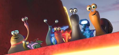 """This film publicity image released by DreamWorks Animation shows, from left, White Shadow voiced by Michael Bell, Smoove Move voiced by Snoop Dogg, Skidmark voiced by Ben Schwartz, Burn voiced by Maya Rudolph, Whiplash voiced by Samuel L. Jackson and Turbo voiced by Ryan Reynolds in a scene from the animated movie """"Turbo."""" (AP Photo/DreamWorks Animation)"""