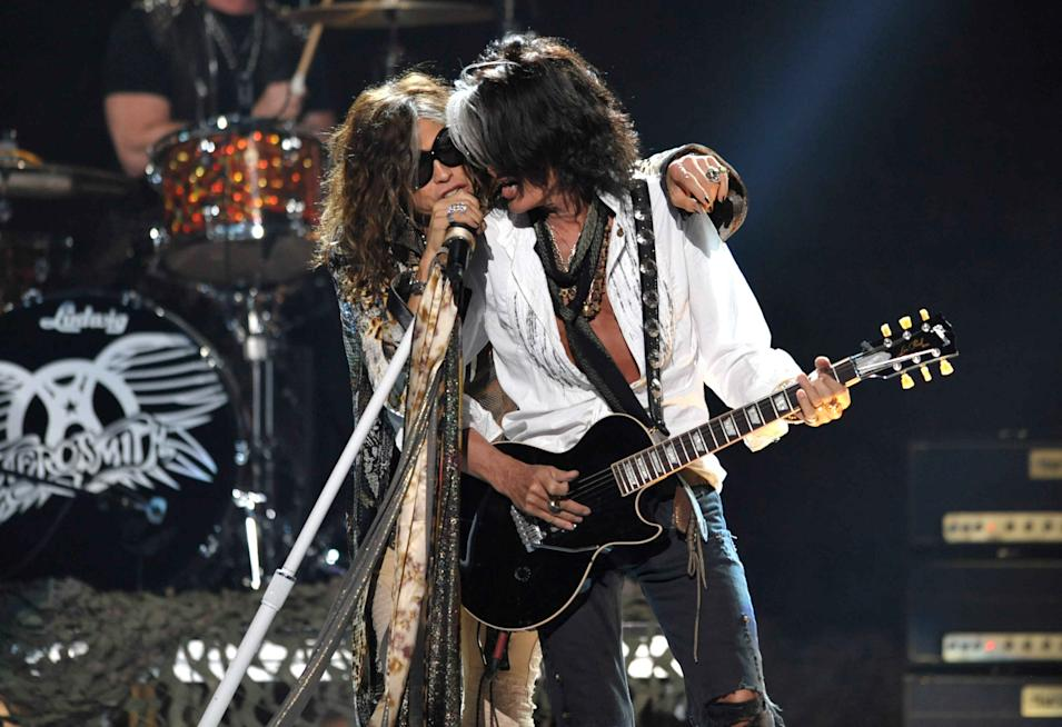 "Steven Tyler, left, and Joe Perry, of musical group Aerosmith, perform onstage at the ""American Idol"" finale on Wednesday, May 23, 2012 in Los Angeles. (Photo by John Shearer/Invision/AP)"