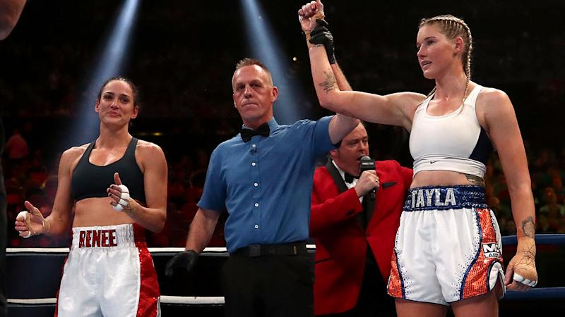 Tayla Harris (R) claimed victory over Renee Gartner (L) in their boxing bout. (Photo by Cameron Spencer/Getty Images)