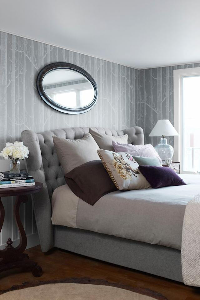 <p>Grays, including a tufted headboard, and lilacs unite in this inviting retreat.  </p>