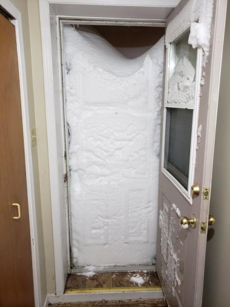 Snow blocks the entrance to an apartment in St Johns, Newfoundland