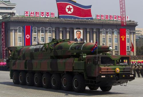 FILE - In this April 15, 2012 file photo, a North Korean vehicle carrying a missile passes by during a mass military parade in Pyongyang's Kim Il Sung Square to celebrate the centenary of the birth of the late North Korean founder Kim Il Sung. The enormous, 16-wheel truck used to carry the missile, likely came from China in a possible violation of U.N. sanctions meant to rein in Pyongyang's missile program, experts say. Pinning a sanctions-busting charge on Beijing would be difficult, however, because it would be hard to prove that Beijing provided the technology for military purposes or even that it sold the vehicle directly to North Korea, the experts said. (AP Photo/David Guttenfelder, File)