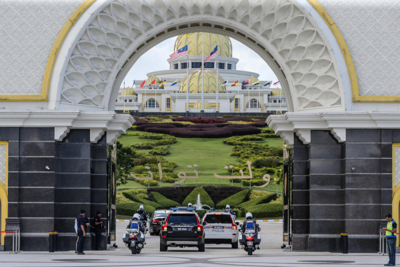 Luxury vehicles believed to be carrying senior political leaders arrive at Istana Negara February 24, 2020. — Picture by Firdaus Latif