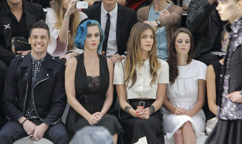 From left, French model Baptiste Giacobini, U.S singer Katy Perry, Italian actress Elisa Sednaoui, and British actress Kaya Scodelario, attend Chanel fashion house presentation for Women's Fall-Winter, ready-to-wear 2013 fashion collection, during Paris Fashion week, Tuesday, March 6, 2012. (AP Photo/Thibault Camus)