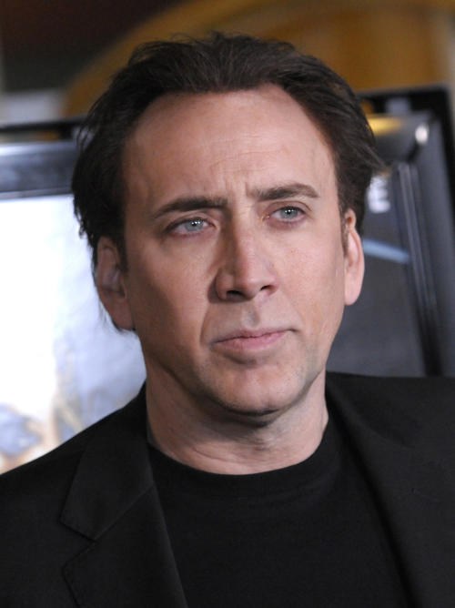 """FILE - In this Feb. 22, 2011 file photo, actor Nicolas Cage arrives at the premiere of the feature film """"Drive Angry"""" in Los Angeles. The story of the police investigation of infamous Alaska serial killer Robert Hansen is headed to the big screen. Cage will portray the Alaska State Trooper who investigated the murders that gripped Anchorage in the 1970s and 1980s. (AP Photo/Dan Steinberg, File)"""