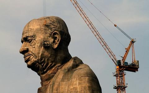 The statue's face was modelled on some 2,000 photos of Patel - Credit: AP