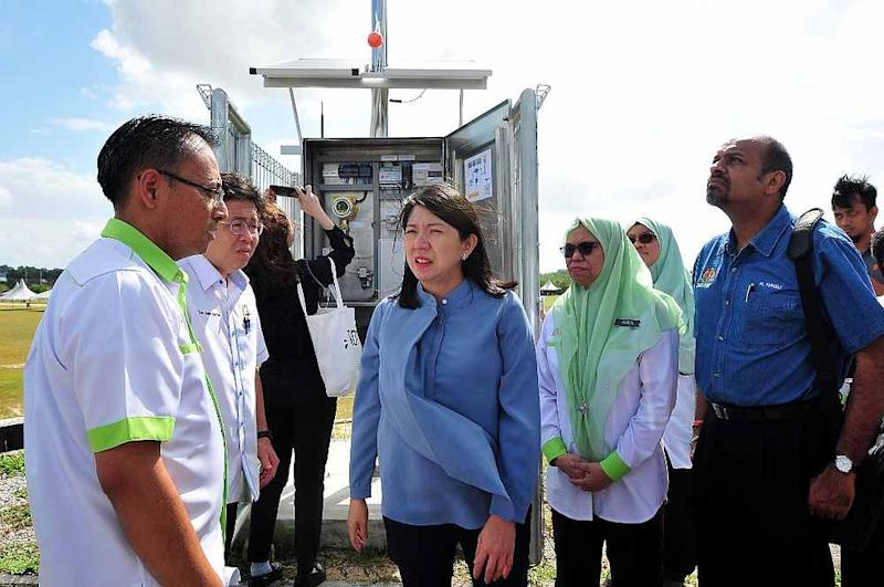 Energy, Science, Technology, Environment and Climate Change Minister Yeo Bee Yin (centre) tests the early warning pollution monitoring system in Pasir Gudang February 23, 2020. — Picture by Ben Tan