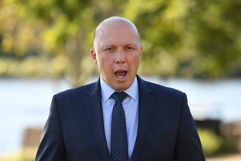Minister for Home Affairs Peter Dutton speaks to the media in Brisbane.