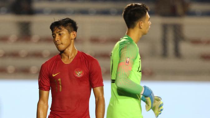 Bek Timnas Indonesia U-22, Firza Andika, saat melawan Singapura U-22 pada laga SEA Games 2019 di Stadion Rizal Memorial, Manila, Kamis (28/11). Indonesia menang 2-0 atas Singapura. (Bola.com/M Iqbal Ichsan)