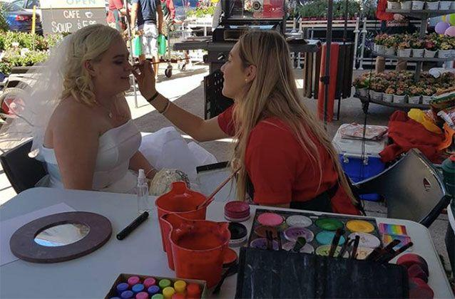 The blushing bride took advantage of the face painter who added a splash of colour on her big day. Picture: Jordan Wilson