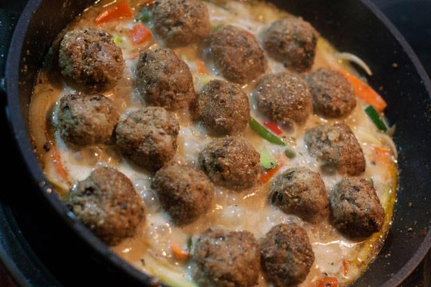 Mexican meatballs are known as albóndigas and are often found in a garlicky, tomato-based soup with rice, potatoes, and other vegetables. The albóndigas themselves typically have rice mixed into them, along with onion, garlic or garlic powder, and black pepper, so their texture is more interesting than the average meatball.