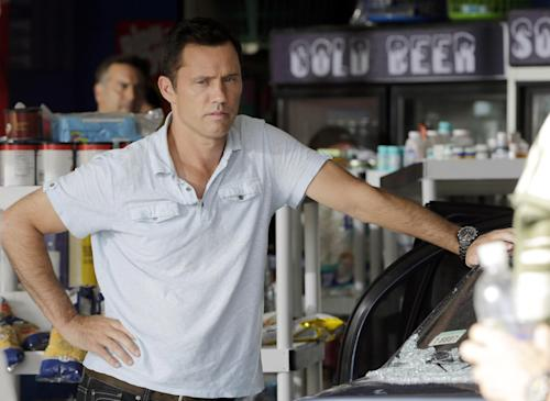 "In this July 24, 2013, photo, Jeffrey Donovan prepares for a rehearsal for an episode of ""Burn Notice"" in Miami. The cable spy drama is coming to an end after seven seasons with a big finale next Thursday, Sept. 12, 2013. (AP Photo/Alan Diaz)"