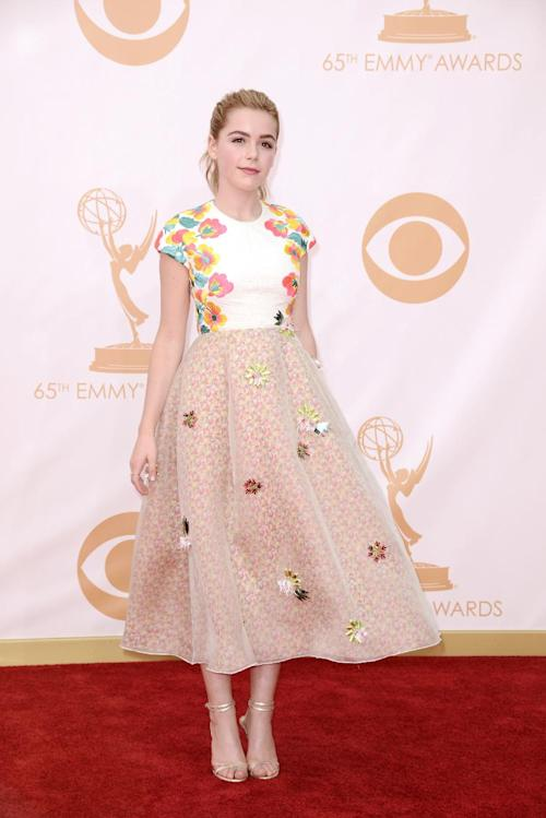 Kiernan Shipka, wearing Delpozi, arrives at the 65th Primetime Emmy Awards at Nokia Theatre on Sunday Sept. 22, 2013, in Los Angeles. (Photo by Dan Steinberg/Invision/AP)