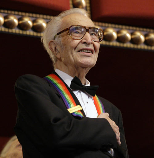 FILE - In this Dec. 6, 2009 file photo, Kennedy Center honoree Dave Brubeck stands for the National Anthem at the Kennedy Center Honors gala in Washington. Brubeck, a pioneering jazz composer and pianist died Wednesday, Dec. 5, 2012 of heart failure, after being stricken while on his way to a cardiology appointment with his son. He would have turned 92 on Thursday. (AP Photo/Alex Brandon, File)