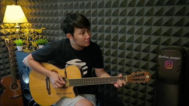 gitaris akustik nathan fingerstyle