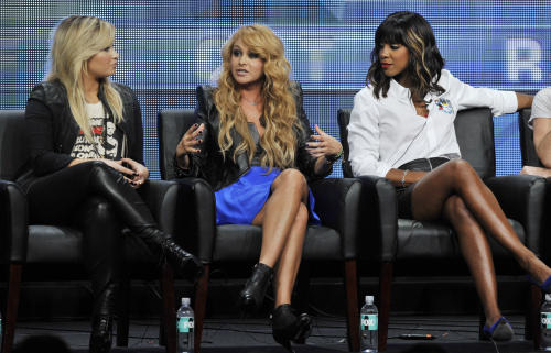 "Paulina Rubio, center, a judge on the FOX series ""The X Factor,"" addresses reporters as fellow judges Demi Lovato, left, and Kelly Rowland look on during the FOX 2013 Summer TCA press tour at the Beverly Hilton Hotel on Thursday, Aug. 1, 2013, in Beverly Hills, Calif. (Photo by Chris Pizzello/Invision/AP)"