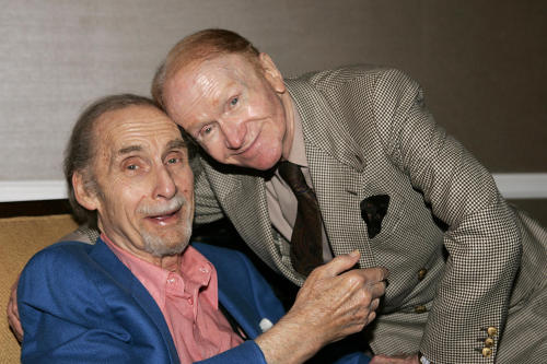 FILE - This July 12, 2005 file photo shows comedians Sid Caesar, left, and Red Buttons at the Television Critics Association PBS Press Tour in Beverly Hills, Calif. Caesar, whose sketches lit up 1950s television with zany humor, died Wednesday, Feb. 12, 2014. He was 91. (AP Photo/Mathew Imaging, Mark W. Davis, File)
