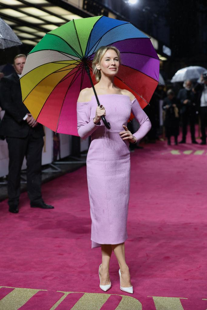 The actress braved the capital's drizzle beneath her very own rainbow [Photo: Getty]