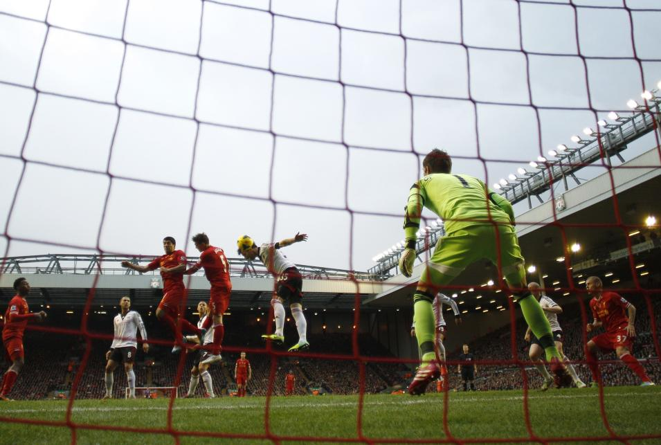 Liverpool's Suarez scores a goal against Fulham during their English Premier League soccer match at Anfield in Liverpool