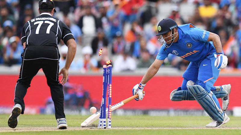 MS Dhoni was run out after an incredible throw from Martin Guptill. (Photo by OLI SCARFF/AFP/Getty Images)