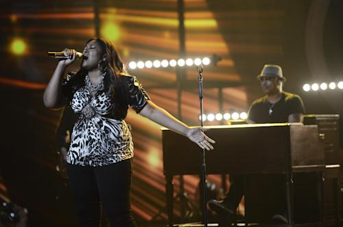"""This publicity photo released by Fox shows Candice Glover, left, performing on """"American Idol,"""" Wednesday, May 8 (8:00-10:00 PM ET/PT) on Fox.The current 12th season is set to conclude Thursday, May 16, 2013, with a showdown between the 23-year-old R&B vocalist Glover of St. Helena Island, S.C., and the 22-year-old country crooner Kree Harrison of Woodville, Texas. (AP Photo/Fox, Michael Becker)"""