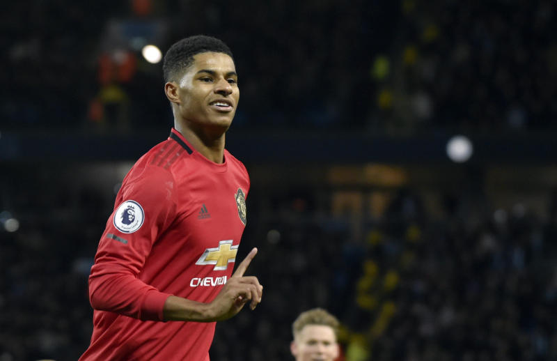 FILE - In this Saturday, Dec. 7, 2019 file photo, Manchester United's Marcus Rashford during their English Premier League soccer match against Manchester City at Etihad stadium in Manchester, England. Paul Pogba and Marcus Rashford are expected to be available for Manchester United whenever the Premier League is allowed to resume after its suspension because of the coronavirus outbreak. Rashford is United's top scorer and Pogba is the club's most high-profile player. They were both sidelined with long-term injuries at the time play was halted in England.  (AP Photo/Rui Vieira, file)