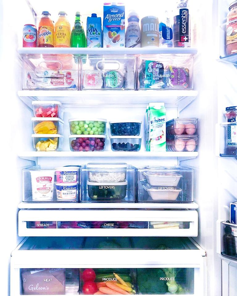"""<p>Teplin says, """"This is a refrigerator we did for Khloé Kardashian—and yes, it made an appearance on <em><a href=""""https://www.nbc.com/keeping-up-with-the-kardashians"""" target=""""_blank"""">Keeping Up With the Kardashians</a></em><em></em>! The more organized your fridge is, the less food waste there will be. In other words, you are <em>way</em> less likely to let your celery go bad if you actually know it's there. Glass food containers and <a href=""""https://www.containerstore.com/s/tall-stackable-wire-basket-with-handles/d?productId=11005670&q=wire%20baskets"""" target=""""_blank"""">wire bins</a> let you store your food in a way that keeps it fresh and visually accessible, while also maximizing your fridge space.""""</p>"""
