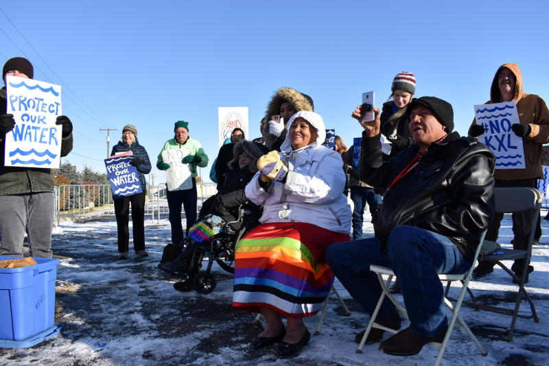 FILE - In this Oct. 29, 2019 file photo, opponents of the Keystone XL oil pipeline from Canada demonstrate in sub-freezing temperatures in Billings, Mont. Alberta is investing $1.1 billion in the disputed Keystone XL pipeline, a project that Alberta Premier Jason Kenney says is crucial for the province's economy. (AP Photo/Matthew Brown, File)
