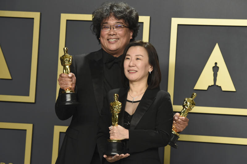 """Bong Joon Ho, left, and Kwak Sin Ae, winners of the award for best picture for """"Parasite"""". pose in the press room at the Oscars on Sunday, Feb. 9, 2020, at the Dolby Theatre in Los Angeles. (Photo by Jordan Strauss/Invision/AP)"""