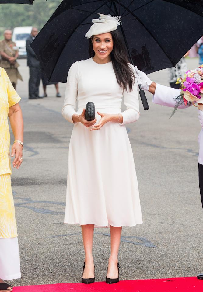 <p></p><p>Meghan also wore her favourite pair of Tabitha Simmons 'Millie' pumps and held onto a Kayu Anna Black Straw Clutch.<br />Photo: Getty </p><p></p>