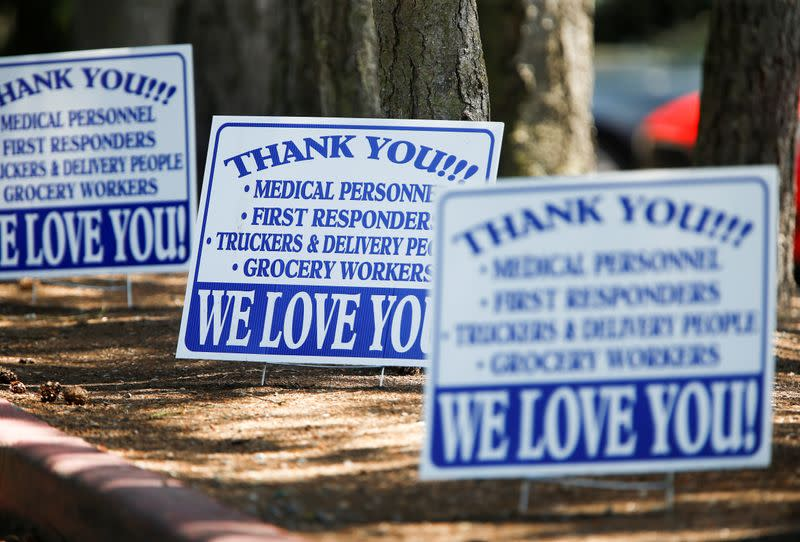 Signs outside Life Care Center of Kirkland, a long-term care facility linked to several coronavirus disease (COVID-19) deaths in Kirkland