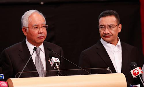 Malaysia's Prime Minister Najib Razak , left, and acting transport minister Hishammuddin Hussein speak during the press conference for the missing Malaysia Airlines jet, MH370, at Putra World Trade Centre (PWTC) in Kuala Lumpur, Malaysia, Monday, March 24, 2014. Malaysian Prime Minister Najib Razak says a new analysis of satellite data indicates the missing Malaysia Airlines plane plunged into a remote corner of the Indian Ocean. The news is a major breakthrough in the unprecedented two-week struggle to find out what happened to Flight 370, which disappeared shortly after takeoff from Kuala Lumpur to Beijing with 239 passengers and crew aboard on March 8. (AP Photo/Vincent Thian)