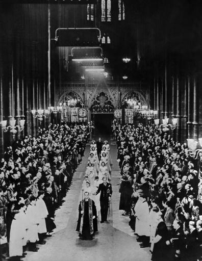 Britain's Princess Elizabeth and Prince Philip walk down the aisle in 1947