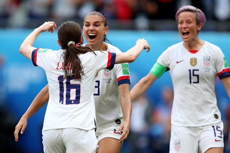 LYON, FRANCE - JULY 07: Rose Lavelle celebrates scoring their 2nd goal with Alex Morgan and Megan Rapinoe of USA during the 2019 FIFA Women's World Cup France Final match between The United States of America and The Netherlands at Stade de Lyon on July 7, 2019 in Lyon, France. (Photo by Marc Atkins/Getty Images)