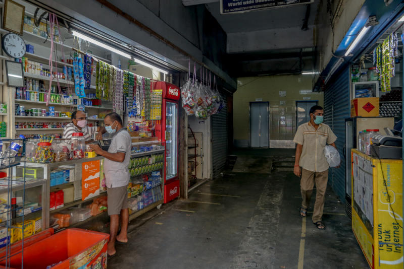 Workers prepare their shops for business during the conditional movement control order (CMCO) in Jalan Masjid India in Kuala Lumpur May 5, 2020. — Picture by Firdaus Latif