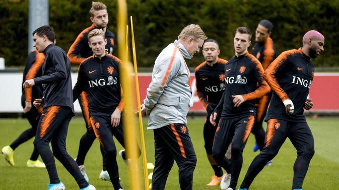 Ronald Koeman meninggalkan Timnas Belanda untuk menangani Barcelona. (Koen van Weel/ANP/AFP)
