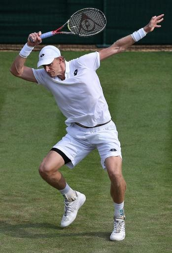 Kevin Anderson returns to Gael Monfils during their fourth round match at Wimbledon