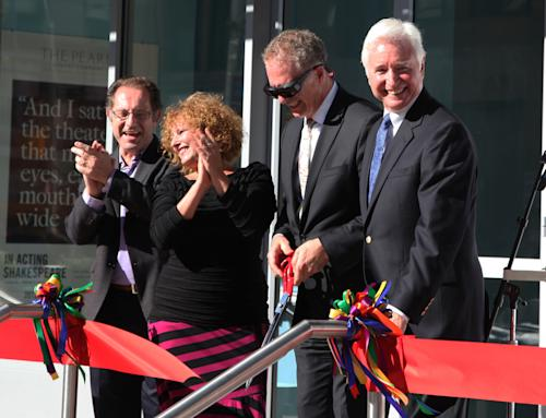 The Pearl Theatre members, from left, Dominick Cuskern, Robin Leslie Brown, board president James Periconi, and artistic director J.R. Sullivan participate in a ribbon-cutting ceremony to celebrate moving into its new home near Times Square, Monday, Oct. 1, 2012 in New York. The Pearl has signed a 20-year lease on its new 160-seat home on 42nd Street, the same venue recently vacated by the Signature Theatre Company. Sullivan, the Pearl's artistic director, said the move to a solid, high-tech building means the company can now plan shows years in the future. (AP Photo/Mark Kennedy)