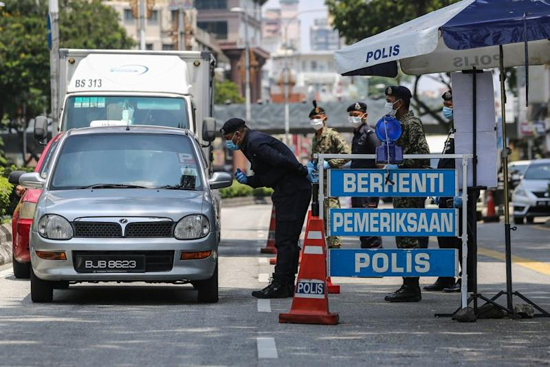 Yesterday saw 687 roadblocks conducted nationwide, with police examinations on 380,342 vehicles. — Picture by Yusof Mat Isa