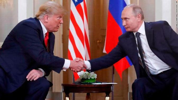 Pertemuan Presiden Amerika Serikat Donald Trump dan Presiden Rusia Vladimir Putin di Helsinki, Finlandia (16/7) (Pablo Martinez / AP PHOTO via CNN)