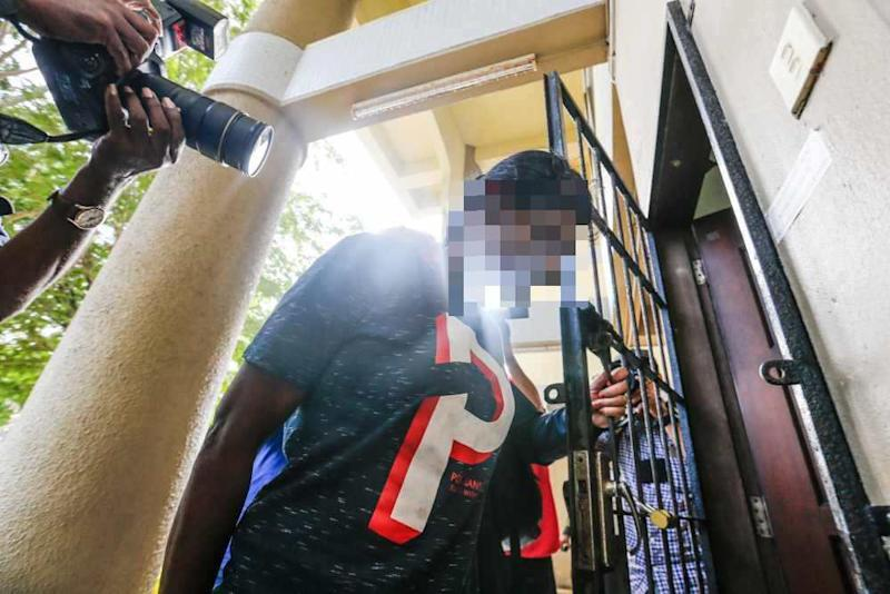 The girl's stepmother is seen at the Sessions Court in Seberang Jaya February 14, 2020.