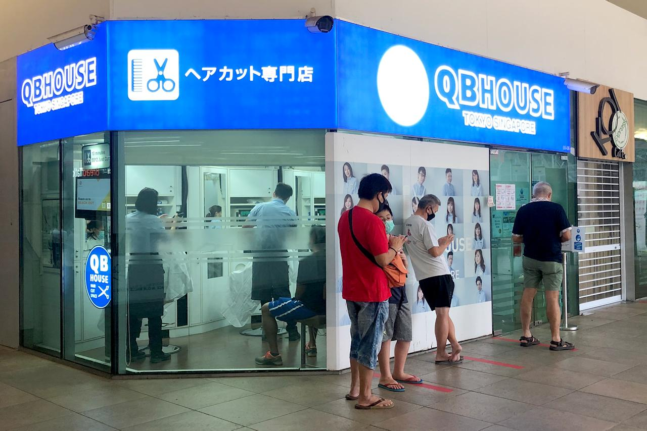 A queue seen outside a barber shop in Bishan on 12 May 2020. (PHOTO: Dhany Osman / Yahoo News Singapore)