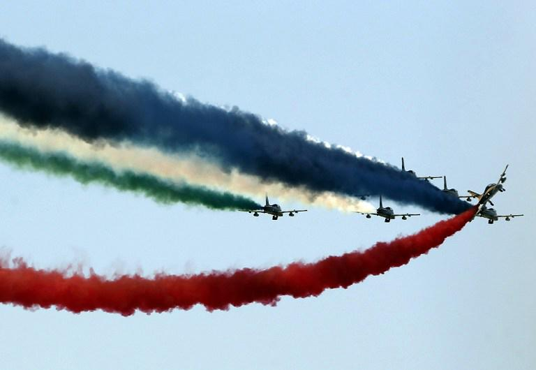 Aircraft leave a coloured smoke trail as they participate in a military show launching the International Defence Exhibition and Conference (IDEX) at the Abu Dhabi National Exhibition Centre in the Emirati capital on February 17, 2013. AFP PHOTO/KARIM SAHIB
