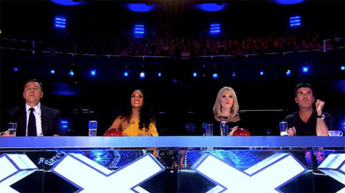 Simon Cowell needs cushion boost to look taller? Rep downplays the evidence
